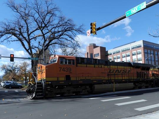 A BNSF Railway train crosses Oak Street in downtown Fort Collins.