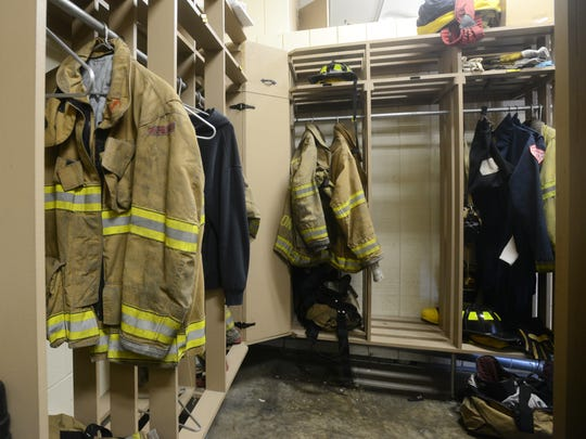Firefighter turnout gear in lockers at Zanesville Fire Department's Central station in downtown Zanesville.