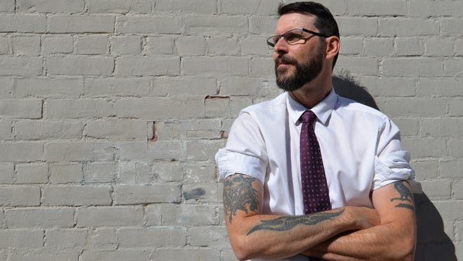 Shan Reil of Milton, an accounts receivable process specialist at Fletcher Allen Health Care, says his tattoos are no problem at work.