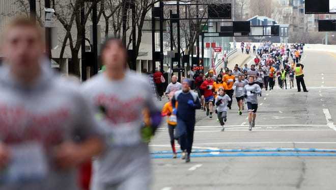 Participants make their way toward the finish line of the Heart Mini 5K Run on Sunday.
