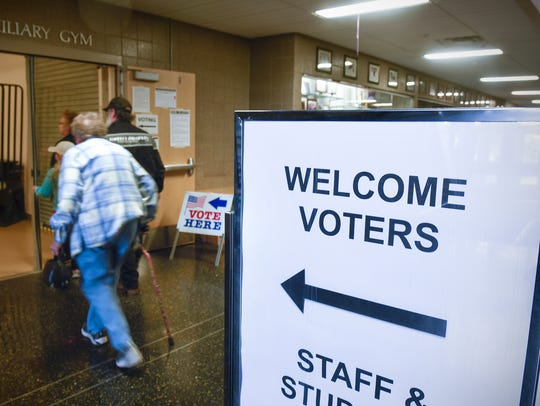 Voters make their way to the polls Tuesday, May 23,