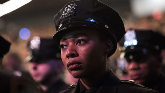 Officer being sworn into NYPD on April 18, 2018.