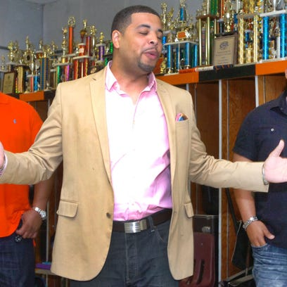 Concert promoter Dustin Cravins, center, welcomes zydeco musicians Keith Frank, left, and Chris Ardoin to the band room at Opelousas High School where they announced a fund-raising concert for the school band's planned trip to the nation's capital.