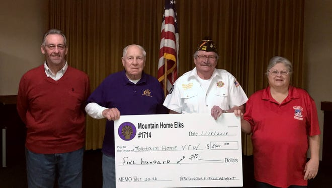 The Mountain Home Elks Lodge recently donated $500 to the Mountain Home VFW Ozark Post 3246 Veterans Relief Fund. The funds came from the annual Elk's Veterans Golf Tournament proceeds. Participating in the donation were: (from left) Clint Gunderson and Albert Underwood, Elk members; William Bradford, VFW commander; and Cathy Underwood, Elks Veterans Services chair.