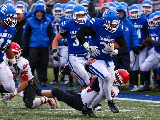 Pulling a Romeo defender behind him is Catholic Central