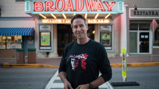 John Smitherman, artistic director for the Broadway Theater in Pitman, stands in front of the theater's recognizable marquee. The theater which will show Pirates of Penzance this fall season.