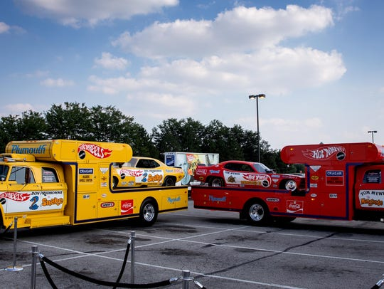 """The cars of former NHRA drivers Don """"The Snake"""" Prudhomme, left, and Tom """"The Mongoose"""" McEwen are displayed before the premiere of the film """"Snake & Mongoo$e"""" in 2013."""
