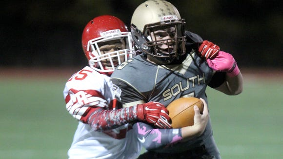 Clarkstown South's Matt Jung is tackled by North Rockland's