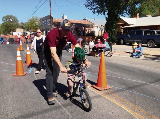 Children participate in the 2014 Kiwanis/Rotary Kids Bicycle Safety Rodeo in Silver City in this file photo. The bicycle rodeo returns to downtown from 9 a.m. until noon Saturday.