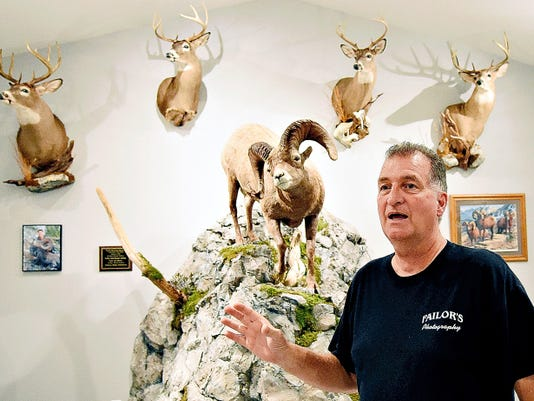 Scott Failor talks about his hunting experiences in his trophy room at his home in Dallastown, Pa. on Thursday, Aug. 20, 2015. Failor says his hobby began by hunting deer with his father at the age of twelve, a tradition still practiced. Dawn J. Sagert - dsagert@yorkdispatch.com