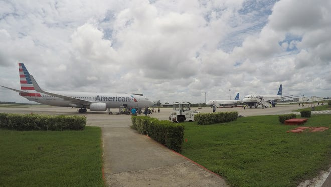 American Airlines and JetBlue Airways charter flights wait to depart from Havana's Jose Marti International Airport.