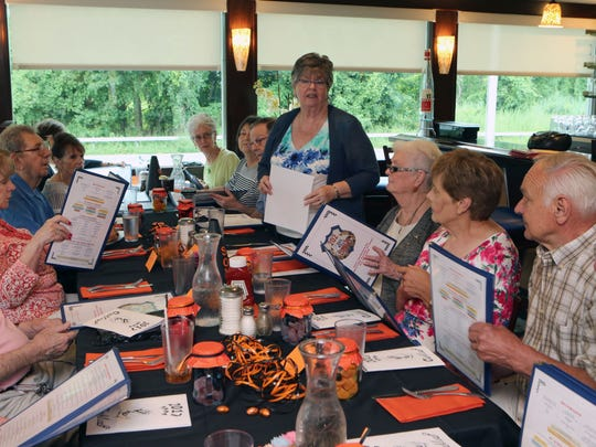 Barbara Powers Hogan welcomes the members of the last Shrub Oak High School Class of 1954, as they gather for a 63rd reunion at the 202 Diner in Cortlandt Manor, Aug. 5, 2017.