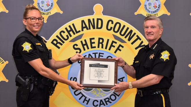 """Rebekah """"Josey"""" Brown is the Deputy of the Second Quarter for Region 6 of the Richland County Sheriff's Office. She's pictured with Richland County Sheriff Leon Lott."""