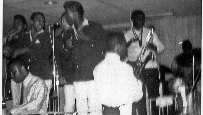 Clarence Clemons, with saxophone, backing the Broadways in Asbury Park in 1964.