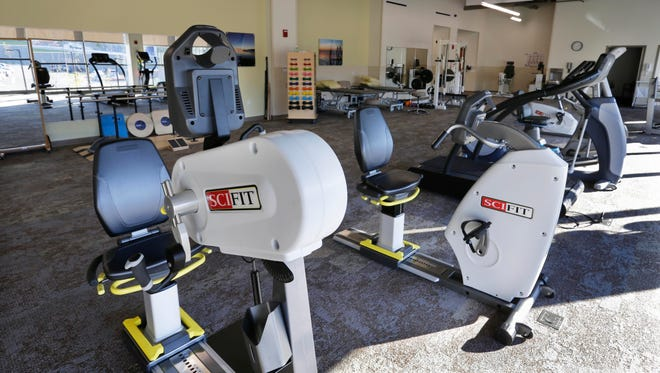 A physical therapy and rehab work area features abundant light and views.