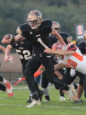 River View's R.J. Hammond carries the ball against Meadowbrook. The Black Bears look for their first win against West Holmes on Friday.