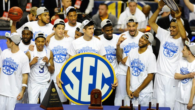 Kentucky players celebrate winning the SEC tournament on Sunday. They are now the favorite to win the NCAA tournament.