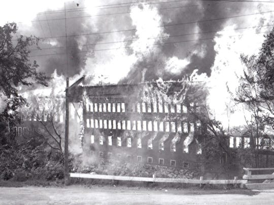 Flames engulf the Bristol Manufacturing Co. in 1947.