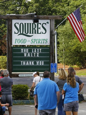 Patrons line up outside Squires to get a table one last time.