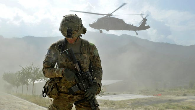 A soldier from the U.S. Army's Bravo Company 2nd battalion 27th infantry regiment secures a landing zone for a Blackhawak helicopter at the Shigal district center in Kunar province on Sept. 15, 2011.