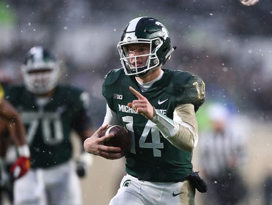 Nov. 18: Brian Lewerke runs 25 yards for a touchdown