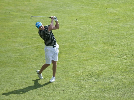 Jay Peak's Bryan Smith hits his second shot on the