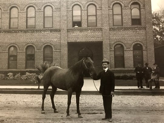 Francis Carr poses with a horse outside Old City Hall in Redding.