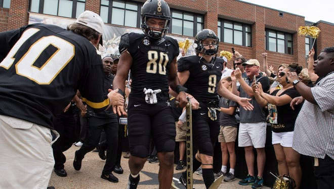 Vanderbilt tight end Jared Pinkney (80) and wide receiver Caleb Scott (9) carry the anchor into the stadium before an NCAA football game between Vanderbilt and Georgia at Vanderbilt Stadium in Nashville, Tenn., Saturday, Oct. 7, 2017.