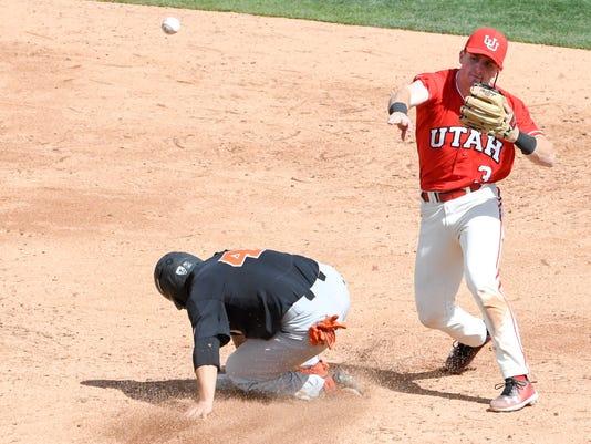 Utah second baseman Oliver Dunn completes a double play against Oregon State during an NCAA college baseball game in Salt Lake City, Utah, Saturday, March 31, 2018. A Utah team that opened the season 0-13 pulled the upset of the college baseball season, winning two of three against top-ranked Oregon State. (Dan Lofgren/University of Utah via AP)