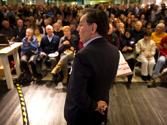 Owner Don Sinex of Devonwood Investors, LLC in New York City begins a presentation outlining the latest redevelopment plan for the Burlington Town Center mall on Tuesday night to a standing-room-only crowd that packed into a vacant store space.