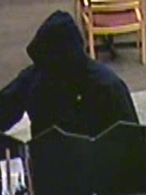 Surveillance footage shows a man suspected of robbing the Public Service Credit Union Thursday night.