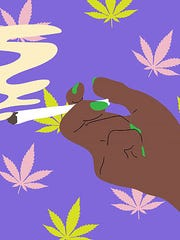 Hand holding a marijuana cigarette