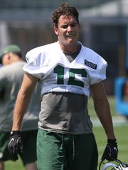 Wide receiver Chad Hansen takes a break during practice.