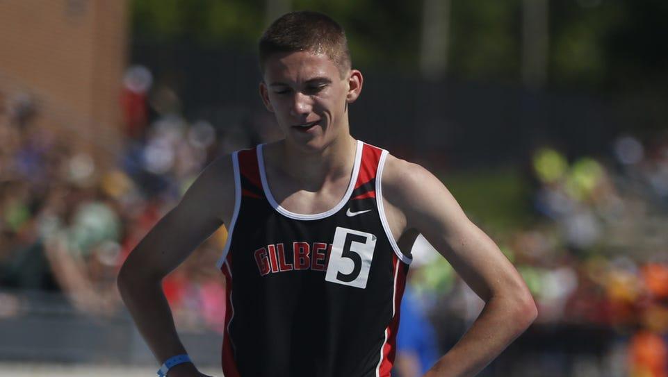 Gilbert's Thomas Pollard crosses the finish Thursday,