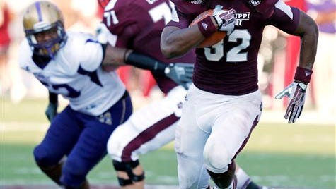 Mississippi State running back Ashton Shumpert (32) runs past a block thrown by teammate offensive lineman Cole Carter as he runs for short yards against Alcorn State during the fourth quarter of their NCAA college football game at the Davis Wade Stadium, Saturday, Sept. 7, 2013 in Starkville, Miss. Mississippi State won 51-7. (AP Photo/Rogelio V. Solis)