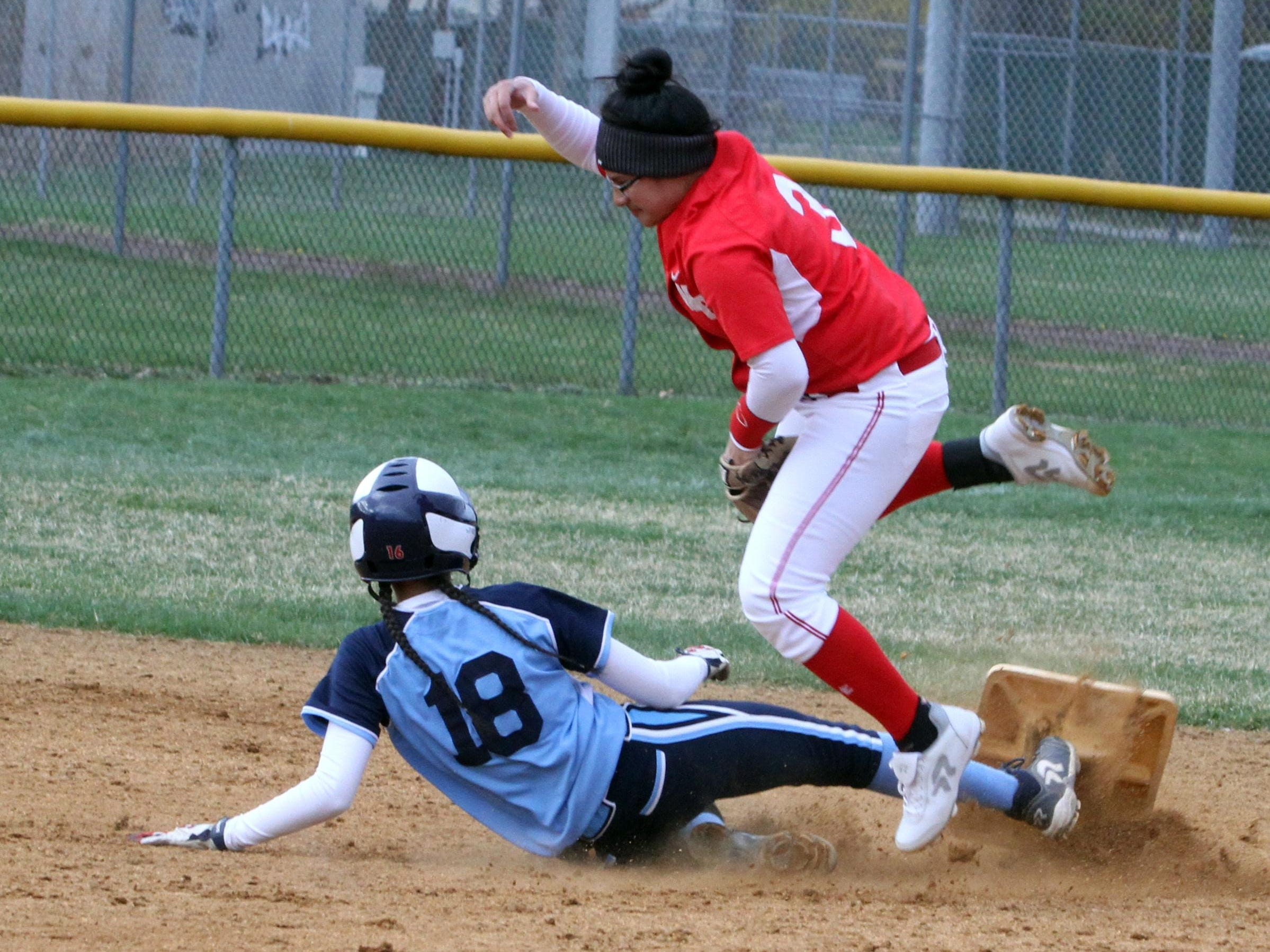 Second base goes flying as Ursuline's Korina Guerra was caught stealing by North Rockland's Deangie Jimenez during a varsity softball game at North Rockland High School April 7, 2016. North Rockland defeated Ursuline 6-5.