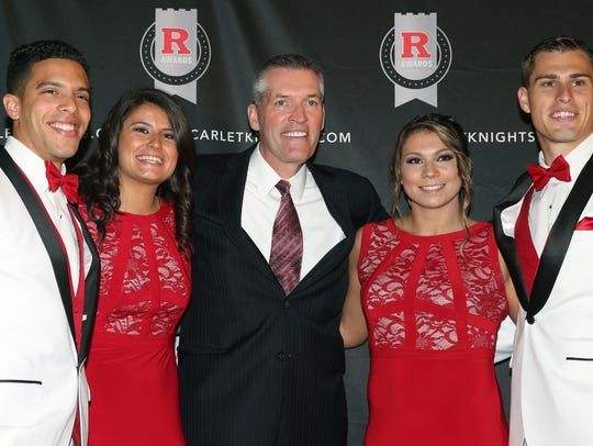 Rutgers athletics director Pat Hobbs (center) and chief