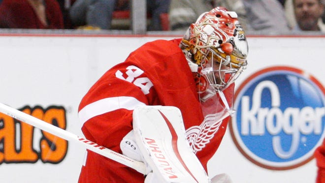 Red Wings goalie Petr Mrazek (34) makes a save against Canadiens center Tomas Plekanec (14) during the second period of the Wings' 3-2 win Thursday at Joe Louis Arena.
