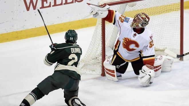 Calgary Flames goalie Niklas Backstrom (32) blocks a shot by the Minnesota Wild's Matt Dumba (24) during the third period on April 9 in St. Paul. The Flames won 2-1.