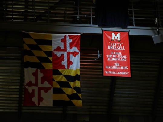 A banner honoring former Maryland men's basketball coach Lefty Driesell hangs from the rafters after being unveiled before an NCAA college basketball game between Maryland and Ohio State, Saturday, Feb. 11, 2017, in College Park, Md. (AP Photo/Patrick Semansky)