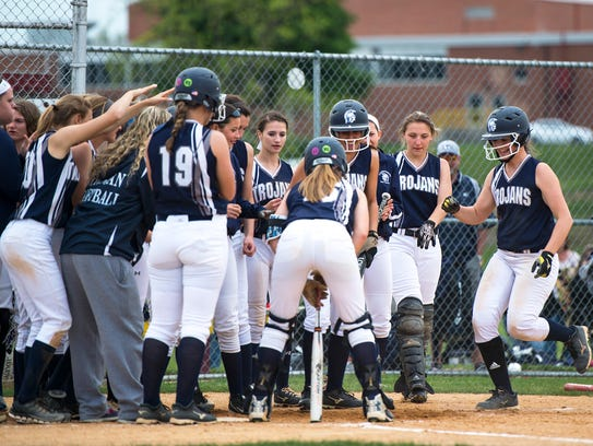 Chambersburg's softball team celebrates with Tara Harmon