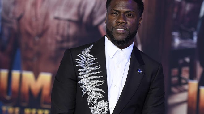 "FILE - Kevin Hart poses for photographers at the premiere of ""Jumanji: The Next Level,"" on Dec. 9, 2019, in Los Angeles. Hart will host the return of a popular telethon once spearheaded by the late Jerry Lewis. The Muscular Dystrophy Association announced Wednesday, Sept. 9, 2020, that Hart will host the MDA Kevin Hart Kids Telethon. The two-hour, star-studded virtual fundraising event will air Oct. 24. Celebrity guests will include Michael B. Jordan, Eva Longoria, Jack Black, Usain Bolt, Josh Gad and Jillian Mercado."