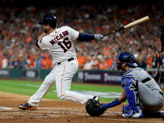 Houston Astros' Brian McCann watches his RBI single against the Los Angeles Dodgers during the second inning of Game 3 of baseball's World Series Friday, Oct. 27, 2017, in Houston. (AP Photo/Matt Slocum)