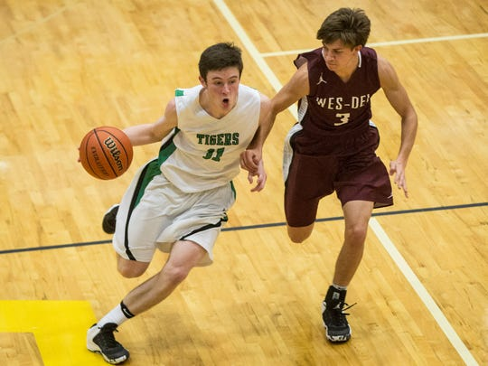 Yorktown's Bobby Smith drives down court during the first round of the Delaware County Boys Basketball Tournament against Wes-Del Tuesday night at Delta High School. Wes-Del won the game 53-44.