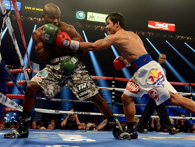 Timothy Bradley Jr. and Manny Pacquiao during their WBO World Welterweight Championship fight at MGM Grand Garden Arena.
