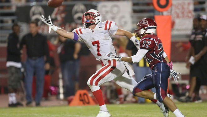 Palm Springs' Riley Hagar(7) just misses a reception vs. La Quinta on Oct. 17. The teams' game on Oct. 16 promises to be another must-see contest.