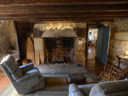 A cozy room in the Headley Inn. The building has several fire places.