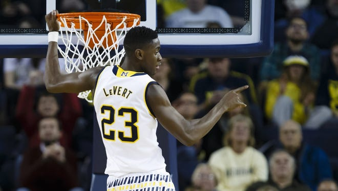 Michigan guard Caris LeVert points to the bench after dunking against Youngstown State on Dec 19, 2015, at the Crisler Center.