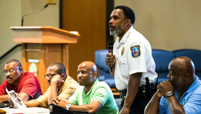 Capt. Faheem Akil of the Wilmington Police Department speaks at a symposium with other officers and members of the National Black Police Association on how to interact with police officers when stopped at the Canaan Baptist Church on Monday evening.