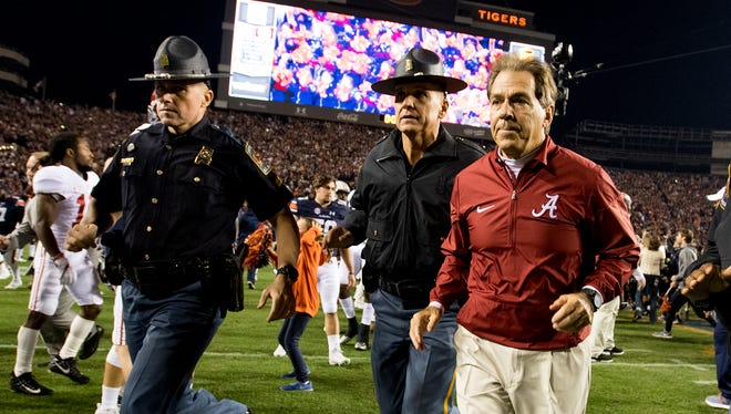 Alabama head coach Nick Saban leaves the field after the Auburn loss in the Iron Bowl in Auburn, Ala. on Saturday November 25, 2017. (Mickey Welsh / Montgomery Advertiser)
